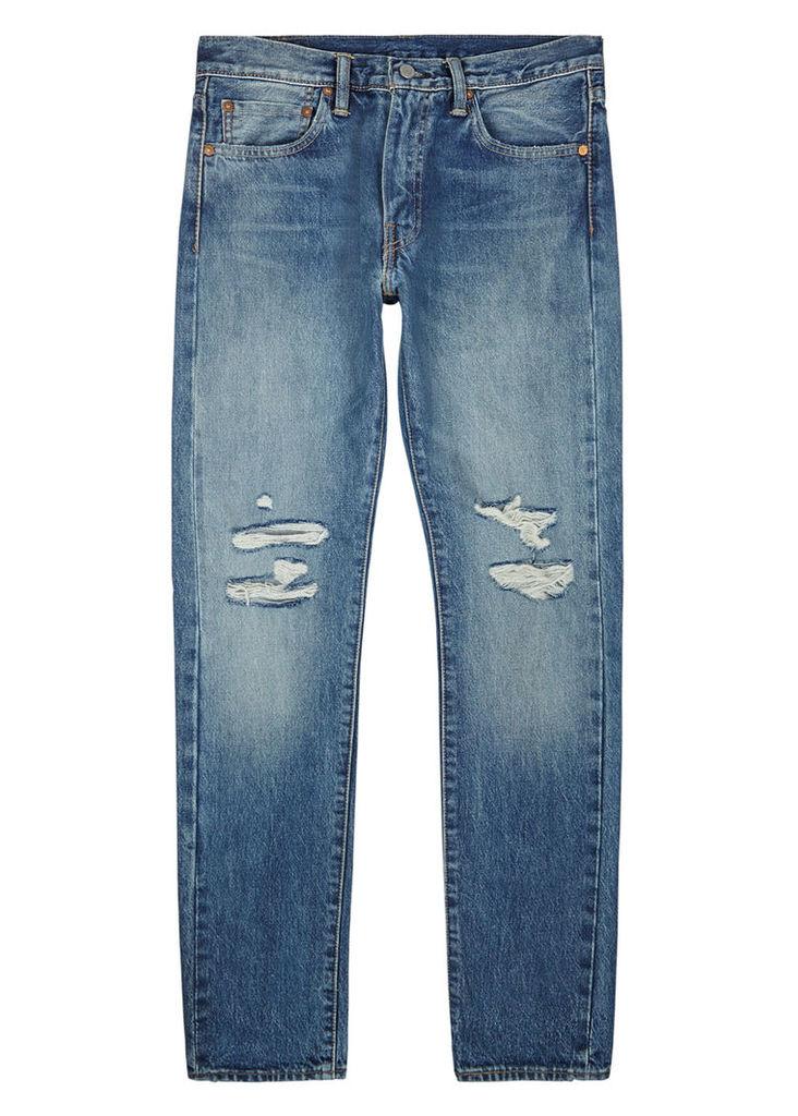 511 blue distressed slim-leg jeans