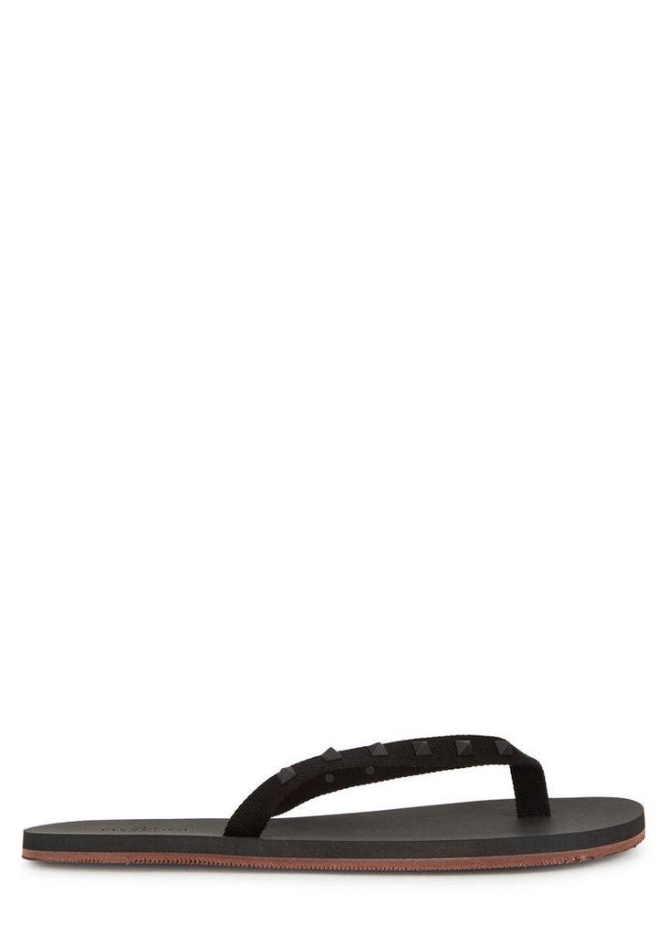 Black studded flip flops