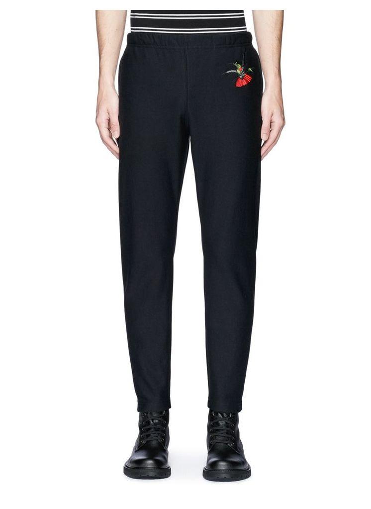 Hummingbird embroidered organic cotton sweatpants