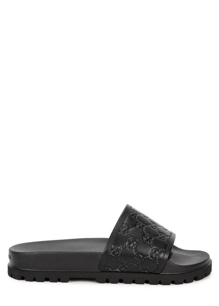 Black monogrammed rubber sliders