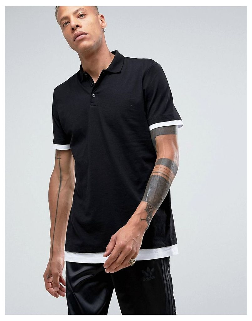 ASOS Longline Polo Shirt With Contrast Cuff And Hem Extender In Black/White - Black