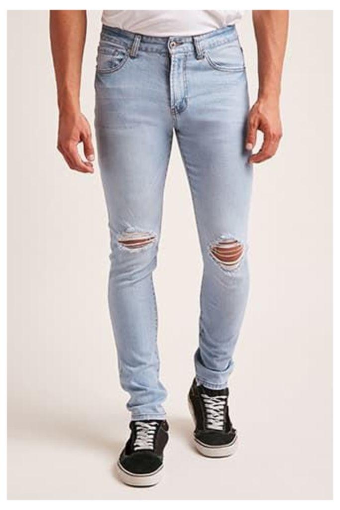 Distressed Knee Skinny Jeans